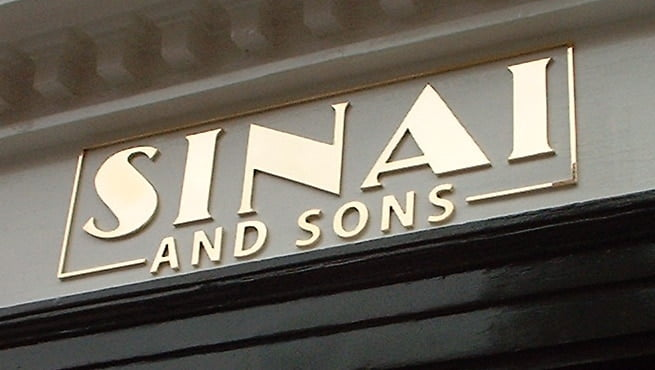 Cut out Letters on Shop front for Sinai and Sons