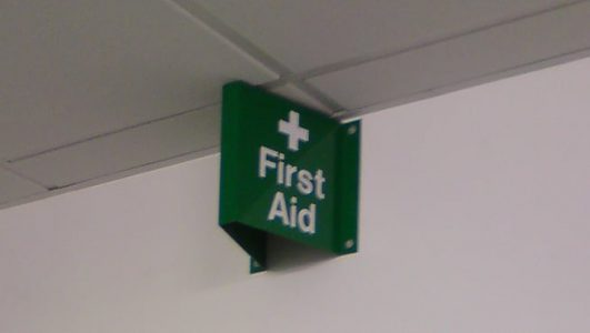 Projecting folded Metal First Aid Sign