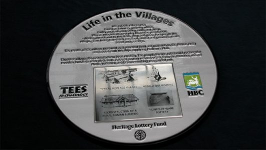 Life in the Village - Cast Aluminium Plaque with Screen Printed Stainless Plate